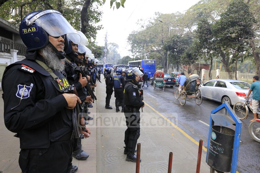 RAB personnel are on high alert near the High Court on Thursday as the capital comes under a security blanket over the verdict of Zia Orphanage Trust graft case against BNP chief Khaleda Zia. Photo: mostafigur rahman