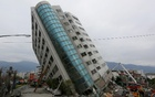 Rescue workers are seen by a damaged building after an earthquake hit Hualien, Taiwan Feb 7, 2018. Reuters
