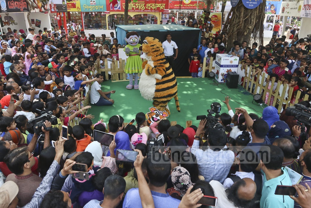Sisimpur puppet show characters amuse children during the Children's Hours at the Amar Ekushey Book Fair on Friday. Photo: Abdullah Al Momin