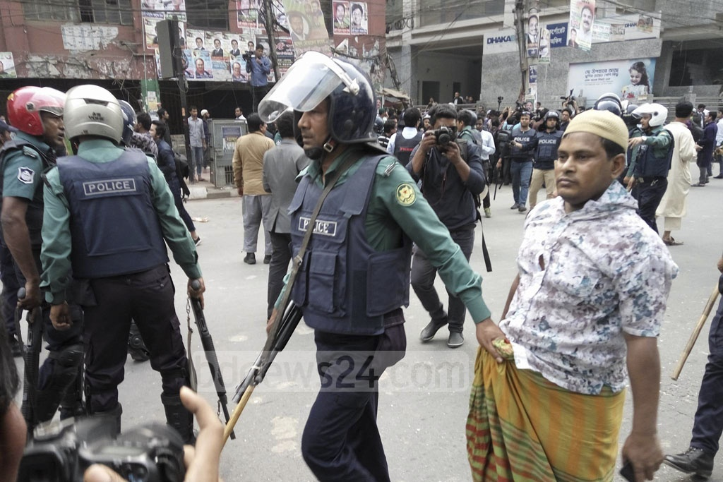 Police arrest one person from the protest rally in front of the BNP office at Nayapaltan on Friday after the party activists protest the jailing of their party chief Khaleda Zia for five years in Zia Orphanage Trust graft case. Photo: Abdullah Al Momin