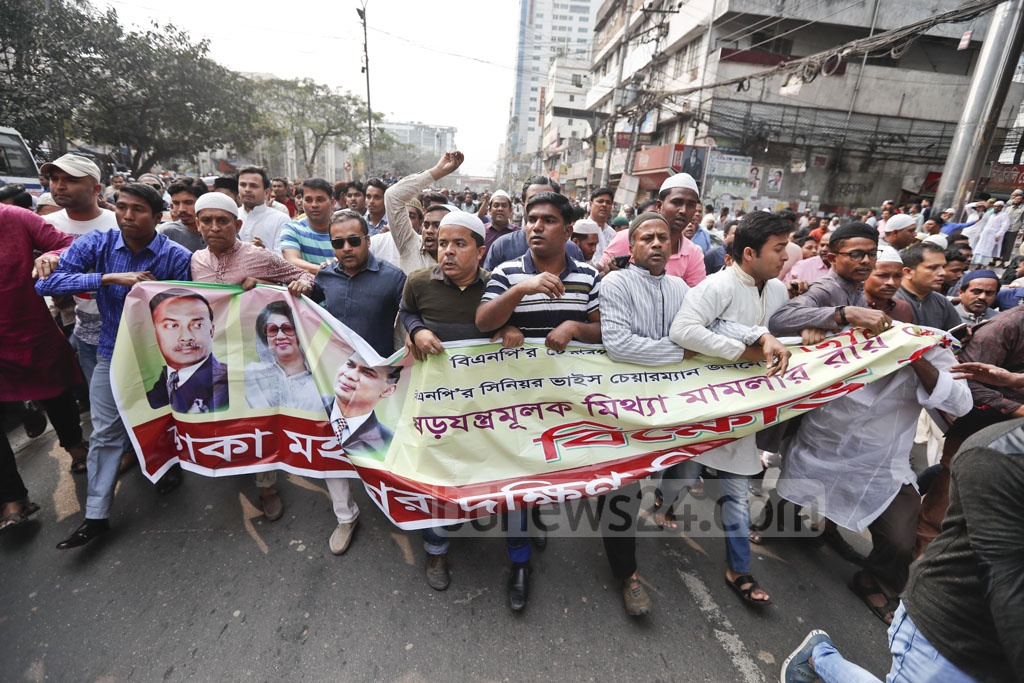 BNP activists and leaders take part in a rally in front of the party office at Nayapaltan on Friday to protest the jailing of their party chief Khaleda Zia for five years in Zia Orphanage Trust graft case. Photo: Abdullah Al Momin