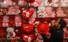 A man inflates a heart shaped balloon ahead of Valentine's day in Peshawar, Pakistan February 7, 2018. Reuters
