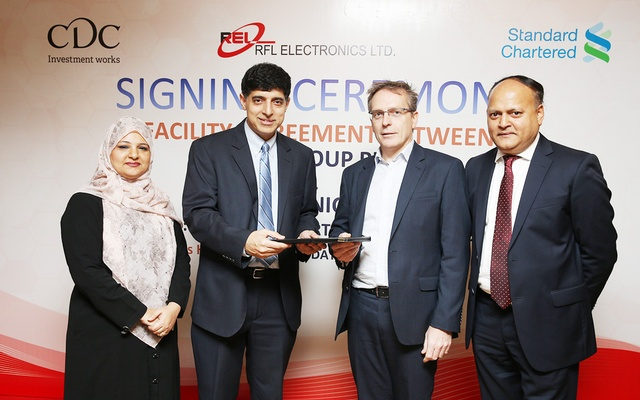 RFL Electronics and CDC sign a loan agreement on Wednesday evening at a Dhaka hotel. (From left) Uzma Chowdhury, Corporate Finance Director, Ahsan Khan Chowdhury, Chairman & CEO of PRAN RFL Group, Richard Palmer, Head of Corporate Debt and Srini Nagarajan, Head of South Asia at CDC.