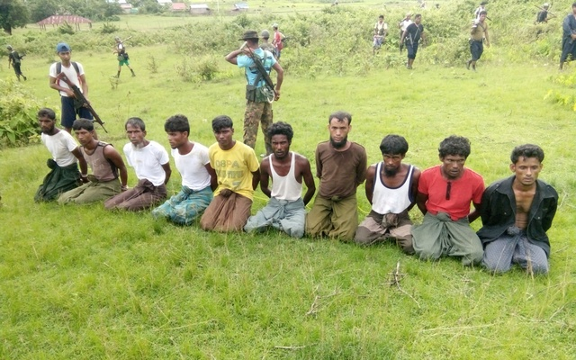 Ten Rohingya Muslim men with their hands bound kneel in Inn Din village Sept 1, 2017. Reuters