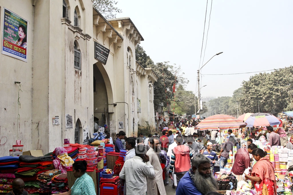 Street hawkers crowd the historic Dhaka Medical College Hospital gate where the Language Movement began its march on Feb 21, 1952. Photo: Abdullah Al Momin