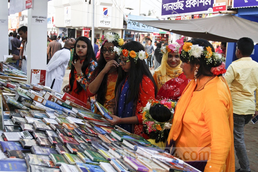 Girls and women dressed in riotous colours, which fully capture the promises, hope and transformation that Bangladeshis yearn for the spring, traipse down the Amar Ekushey Book Fair in Dhaka on Tuesday. Photo: asif mahmud ove