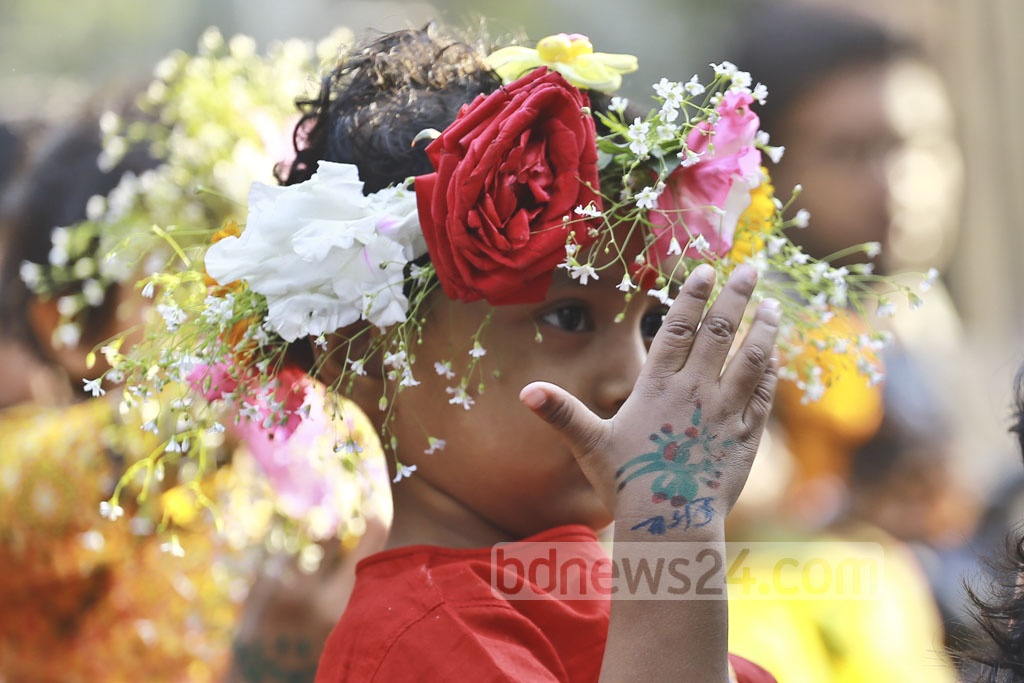 A little girl, adorned with traditional Bengali spring colours, join the Falgun celebration at the Dhaka University's Faculty of Fine Arts where hundreds of participants gather on Tuesday, the first day of the Falgun, the Bengali month of the spring season. Photo: Mahmud Zaman Ovi