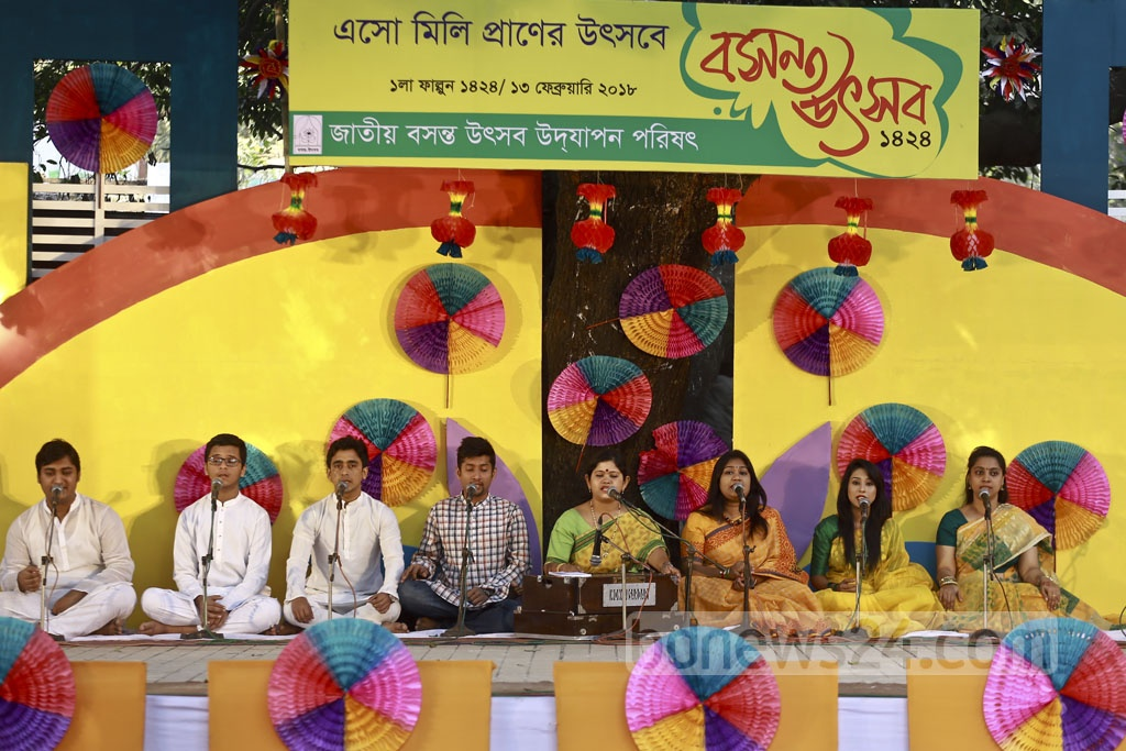 A group of singers take part in the chorus at the Falgun celebration at the Dhaka University's Faculty of Fine Arts where hundreds of participants in traditional spring colours gather on Tuesday, the first day of the Falgun, the Bengali month of the spring season. Photo: Mahmud Zaman Ovi