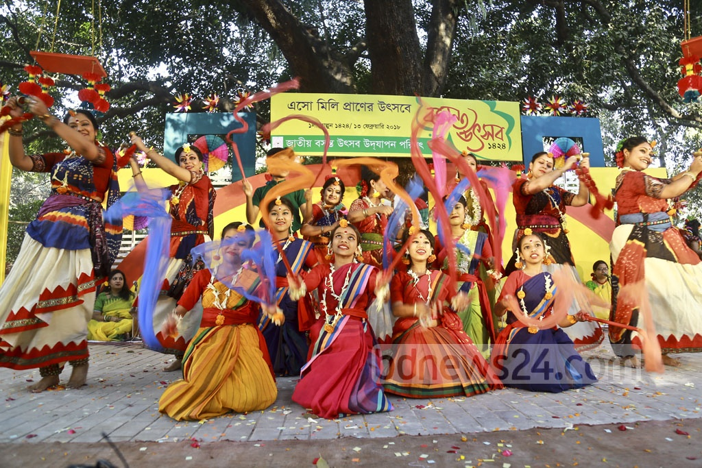 A dance sequence from Dhaka University's Faculty of Fine Arts where hundreds of participants in traditional spring colours gather for the celebration of the Falgun on Tuesday, first day of the Bengali month of the spring season. Photo: Mahmud Zaman Ovi