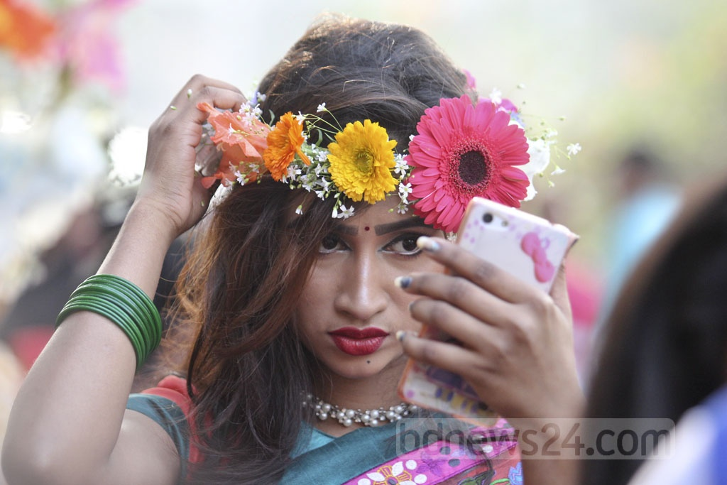 Time for a 'selfie' to capture the postcard-perfect moments of the spring festival. Photo: asif mahmud ove