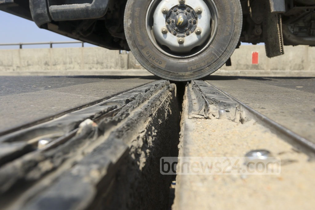 Motorists take a risky ride to cross the Shitalakkhya River in Demra through the Sultana Kamal Bridge as the protective rubber coating on expansion joints has come off. Photo: Abdullah Al Momin