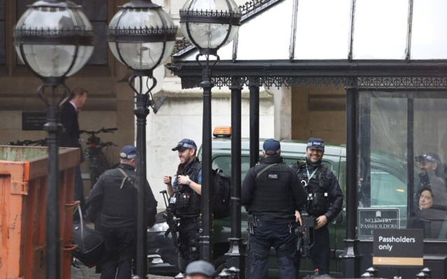 Armed police gather outside an entrance to the Houses of Parliament in London, Britain February 13, 2018. Reuters