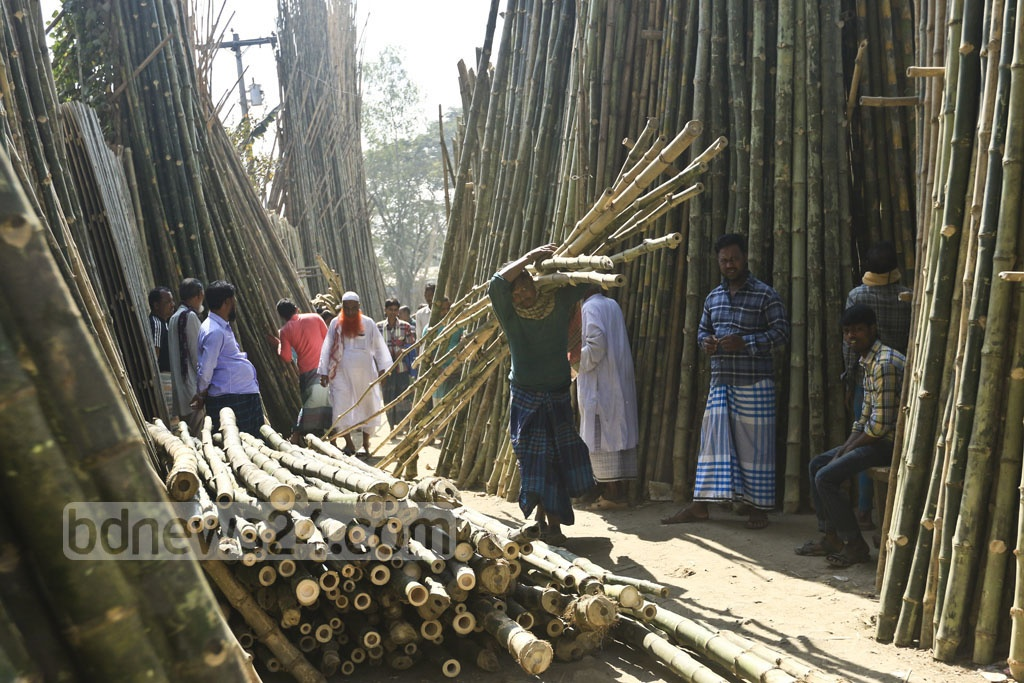 A worker carrying bamboos.