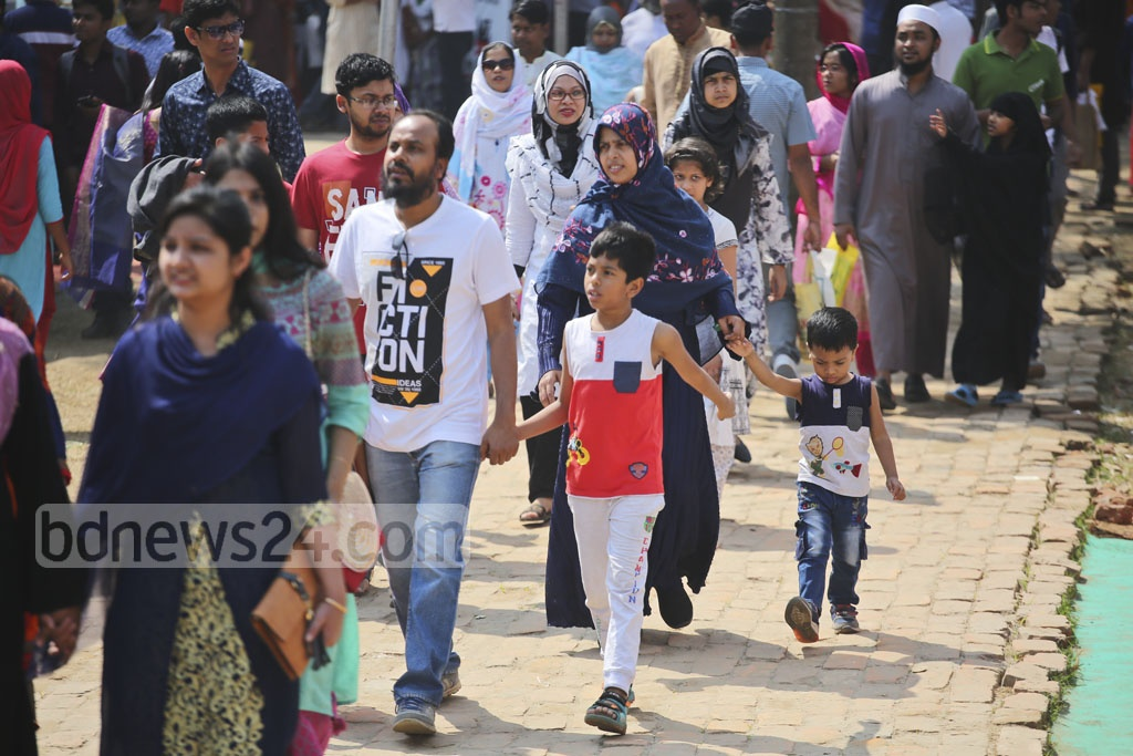 Children walk along their parents at the Amar Ekushey Book Fair on Friday. Photo: Mahmud Zaman Ovi