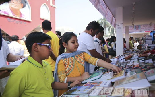 Little book-lovers looking for their picks at the Suhrawardy Udyan premises of the Amar Ekushey Book Fair during children's hours on Friday. Photo: Mahmud Zaman Ovi