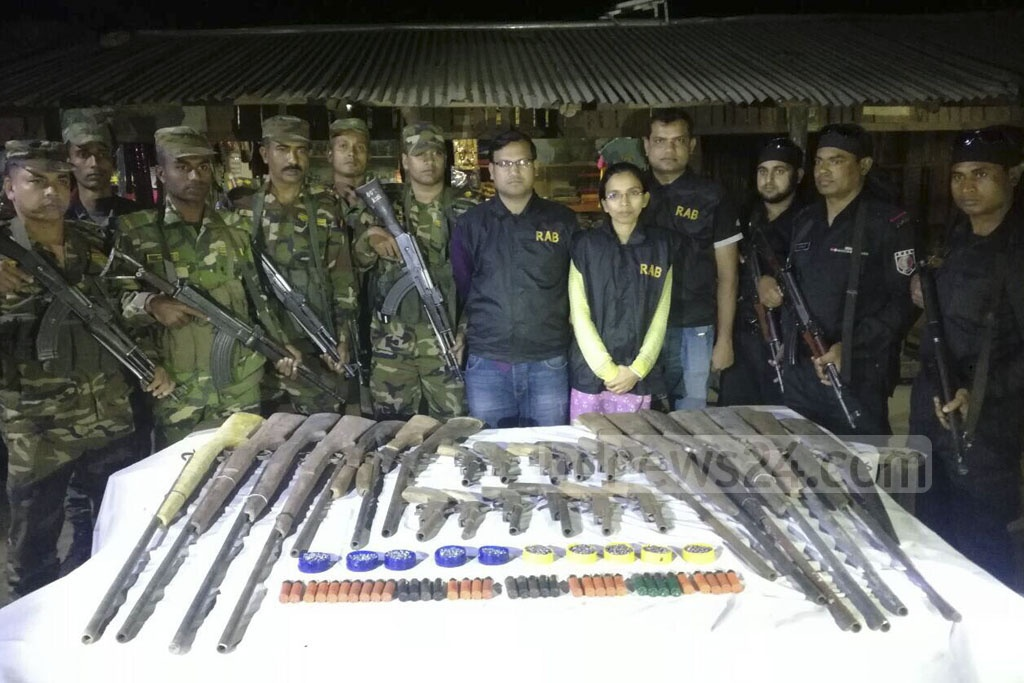 A team of army and Rapid Action Battalion seized a large cache of arms and ammunition and arrested four people in an overnight drive that ended early in the morning in Bandarban's Lama on Friday.