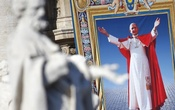 FILE PHOTO: The tapestry with the image of Pope Paul VI is unveiled as Pope Francis celebrates the mass for his beatification in St. Peter's square at the Vatican October 19, 2014. Reuters