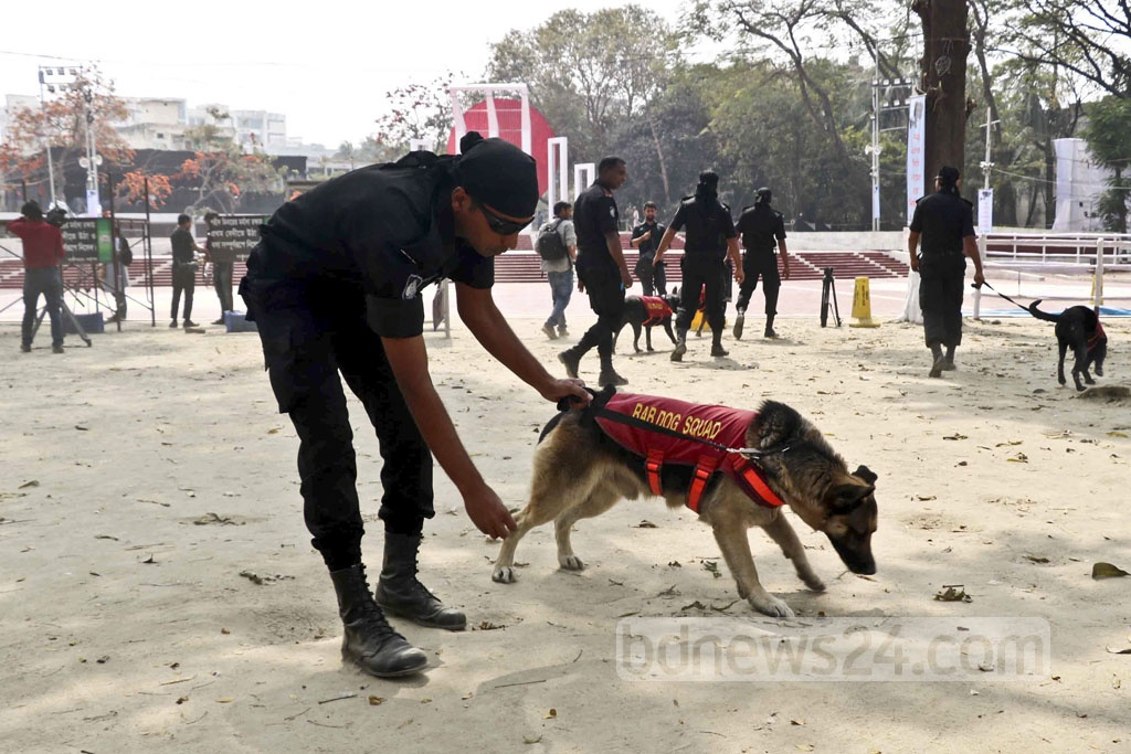 The Rapid Action Battalion or RAB uses sniffer dogs at the Central Shaheed Minar as part of security sweeps on Tuesday, a day before the International Mother Language Day.