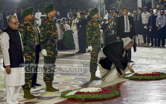Prime Minister Sheikh Hasina places a wreath at the Central Shaheed Minar in Dhaka in the first hour of International Mother Language Day on Feb 21. Photo: Saiful Islam Kallol