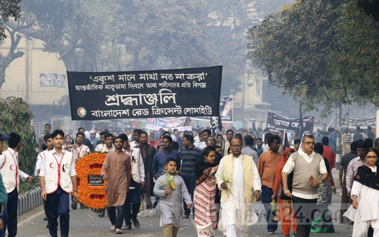 With wreaths and banners, different organisations march to the Central Shaheed Minar in Dhaka on International Mother Language Day on Wednesday. Photo: asif mahmud ove