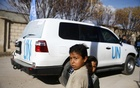 Children stand near a UN vehicle in the village of Otaya, eastern Ghouta, in Damascus, Syria February 14, 2018. Reuters