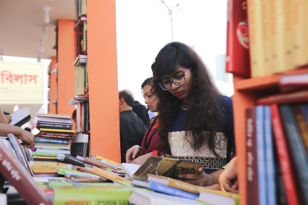 Many young readers search for the books of their favourite writers at the Amar Ekushey Book Fair on Friday, the last weekly holiday before the month-long fair ends. Photo: Mahmud Zaman Ovi