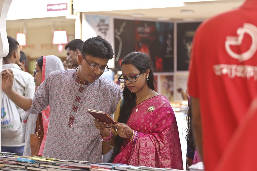 Many visitors came with their family members and loved ones to the Amar Ekushey Book on Friday, the last weekly holiday before the month-long fair ends. Photo: Mahmud Zaman Ovi