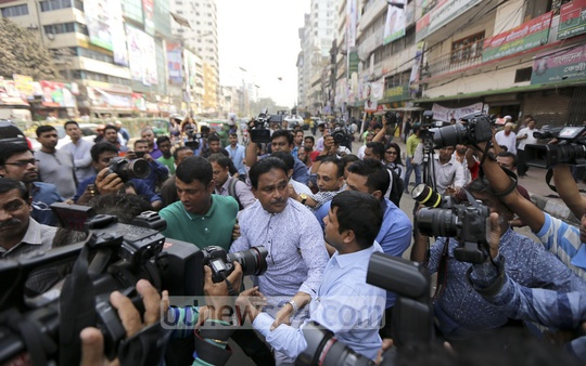Police detain BNP Joint Secretary General Syed Moazzem Hossain Alal as he leaves a press conference protesting police action against the protest.