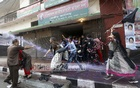 Police use water cannons to crack down on BNP activists holding a protest in front of the party's headquarters in Dhaka's Naya Paltan on Saturday.