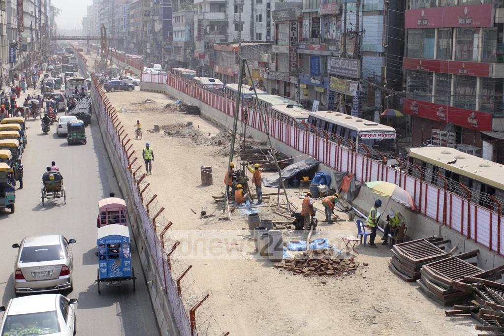 Construction workers at work on the Dhaka metro rail project at Shaorapara on Sunday. Photo: asif mahmud ove