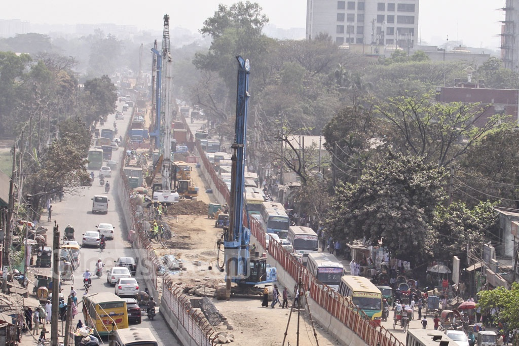 Heavy construction machinery at work on the metro rail project in Dhaka's Agargaon. Photo: asif mahmud ove