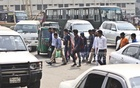 Typical jaywalkers in Dhaka: Pedestrians crossing the road at the city's Karwan Bazar amid moving vehicles. Photo: Abdullah Al Momin