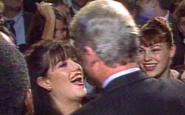 File Photo: President Bill Clinton greets Monica Lewinsky (L) at a Washington fundraising event in October 1996. Reuters