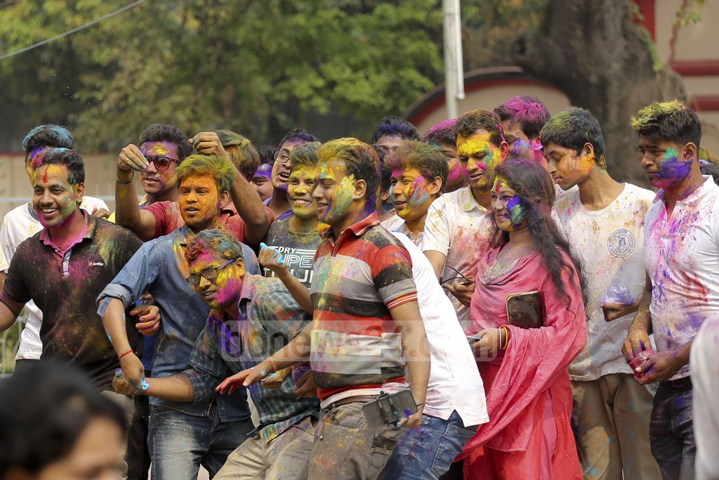 Hindus paint each other with colours during Dol festival at the Dhakeshwari National Temple in the capital on Thursday.