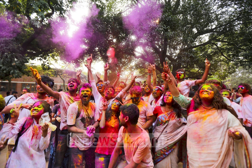 Students spray colours during Dol festival at Dhaka University's Faculty of Fine Arts on Thursday.