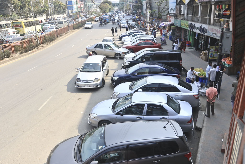 In sheer disregard for traffic rules publicised by Dhaka Metropolitan Police, drivers have haphazardly parked cars on a busy road in Dhaka's Sobhanbagh neighbourhood. Photo: Abdullah Al Momin
