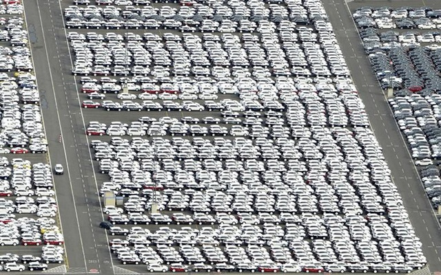 File Photo: Cars for export stand in a parking area at a shipping terminal in the harbour of the northern German town of Bremerhaven, late Oct 8, 2012. Reuters