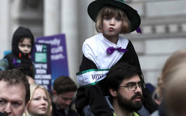 A child dressed as a suffragette demonstrates during the March4Women event in central London, Britain March 4, 2018. REUTERS