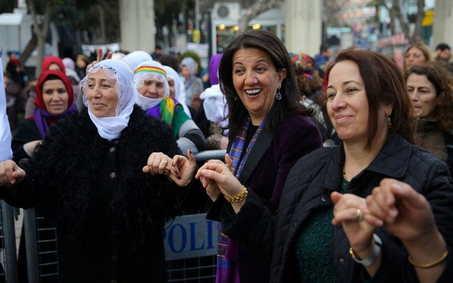 Pervin Buldan, co-leader of Turkey's main pro-Kurdish Peoples' Democratic Party (HDP), dances with her supporters during a Women's Day rally in Istanbul, Turkey March 4, 2018. REUTERS