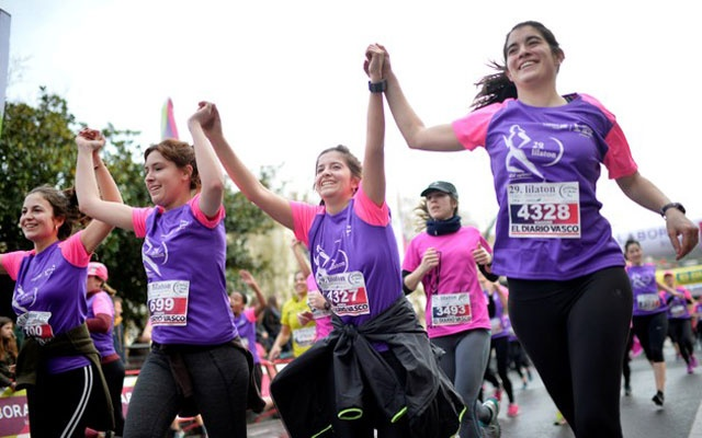 Participants in the Lilathon road race raise their arms as they cross the finish line in the Basque coastal city of San Sebastian, Spain March 4, 2018. According to organisers, thousands of women took part in the 5km (3.10 miles) race in favor of women's rights, ahead of Thursday's International Women's Day. REUTERS