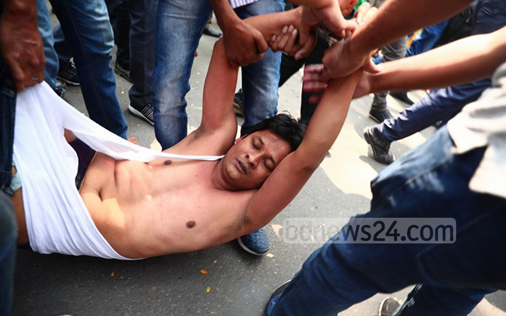 Plain-clothes policemen drag out a BNP activist from the party's sit-in demonstration in front of Dhaka's press club on Thursday.