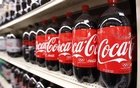 Bottles of Coca Cola are seen in a store display in New York Feb 9, 2010. Reuters