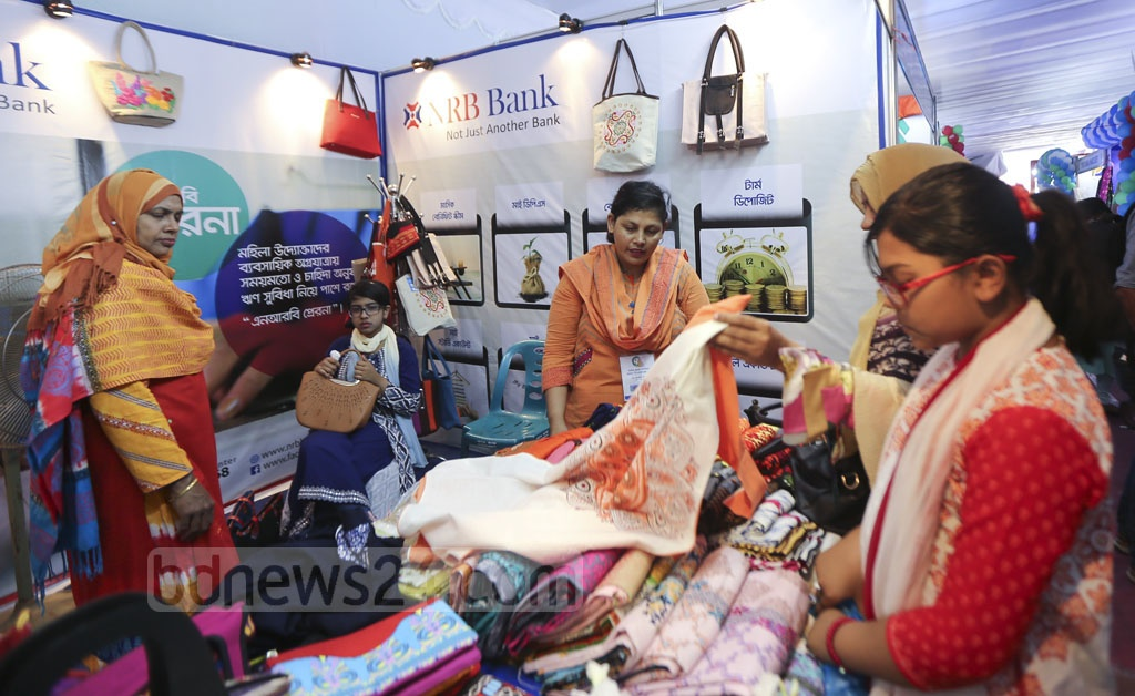 Visitors check products at a stall of Banker-SME Women Entrepreneur Meet and Product Display 2018 on the Shishu Academy premises in Dhaka on Saturday. Photo: Mahmud Zaman Ovi
