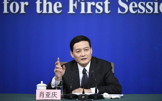 Xiao Yaqing, head of the State-owned Assets Supervision and Administration Commission (SASAC), answers questions at a press conference on reform and development of state-owned enterprises on the sidelines of the first session of the 13th National People's Congress in Beijing, capital of China, Mar 10, 2018. Xinhua