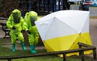 The forensic tent, covering the bench where Sergei Skripal and his daughter Yulia were found, is repositioned by officials in protective suits in the centre of Salisbury, Britain, Mar 8, 2018. Reuters