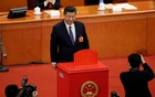 Chinese President Xi Jinping looks on after dropping his ballot during a vote on a constitutional amendment lifting presidential term limits, at the third plenary session of the National People's Congress (NPC) at the Great Hall of the People in Beijing, China Mar 11, 2018. Reuters