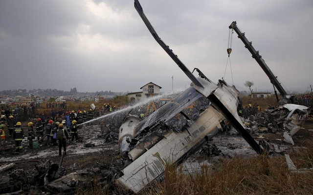 Rescue workers work at the wreckage of a US-Bangla airplane after it crashed at the Tribhuvan International Airport in Kathmandu, Nepal March 12, 2018. REUTERS