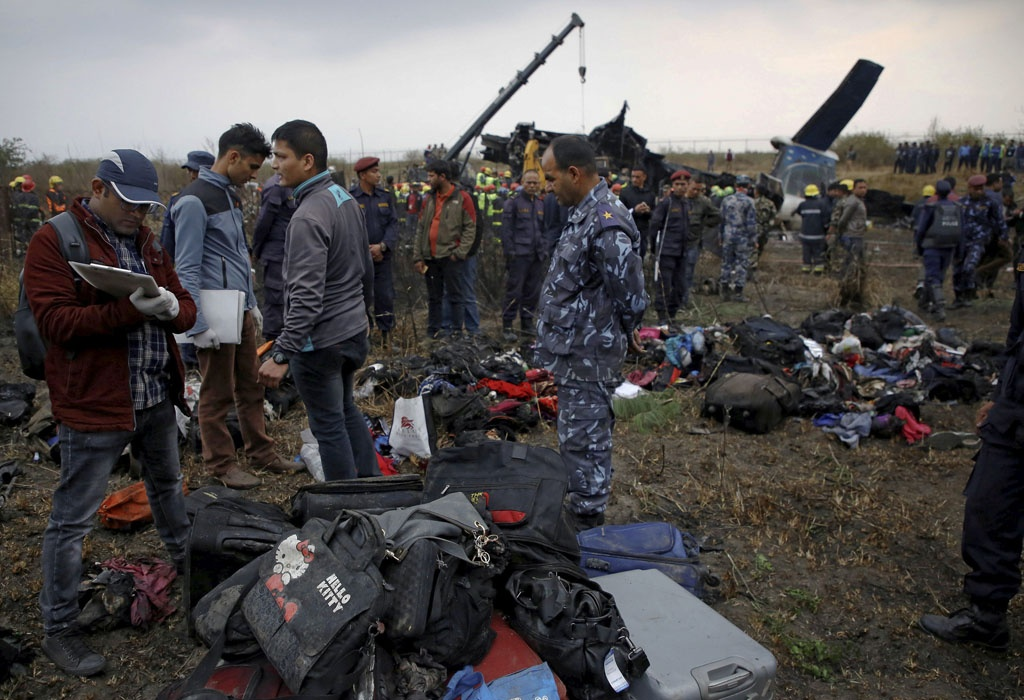 Officials check the belongings recovered from the cash site of a US-Bangla airplane at Tribhuvan International Airport in Kathmandu, Nepal March 12, 2018. REUTERS