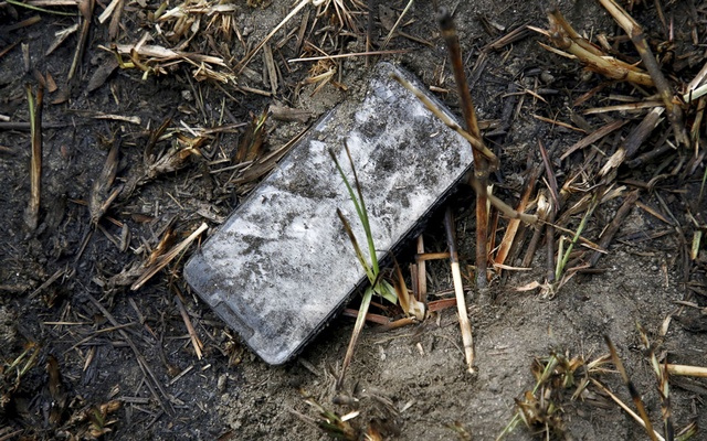 A cellphone lies near the crash site of a US-Bangla airplane at Tribhuvan International Airport in Kathmandu, Nepal March 12, 2018. REUTERS