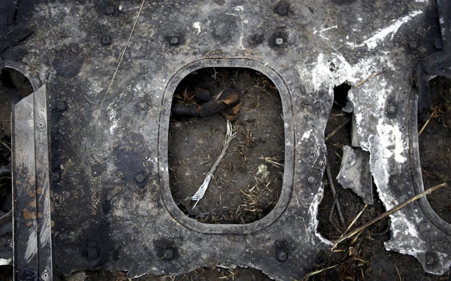 A wreckage of a US-Bangla airplane is seen near the crash site at Tribhuvan International Airport in Kathmandu, Nepal March 12, 2018. REUTERS